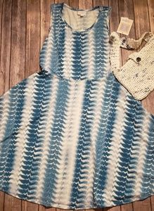 This is a BNWT lularoe Nicki swing dress!